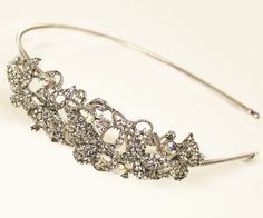 Side accent bridal headband tiara featuring high quality rhinestones in an adorable butterfly design.
