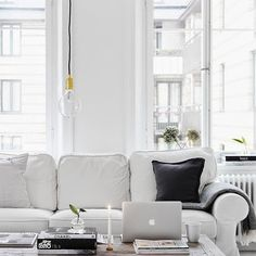 Elegant white living room via Milo and Mitzy.