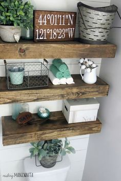 Farmhouse Master Bathroom Reveal - Love these floating bathroom shelves above the toilet and faux shiplap accent wall!