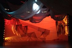 "Luscombe Collaboration ""Beyond the Armor"" WMU Lighting Designer: Evan Carlson Scenic Designer: Caitlin Eby"
