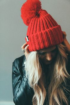A red knit hat and leather jacket create a very cool winter look! | Mary Kay