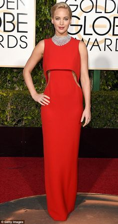 Another winning look: Jennifer looked beautiful in her scarlet Dior dress, paired with mat...