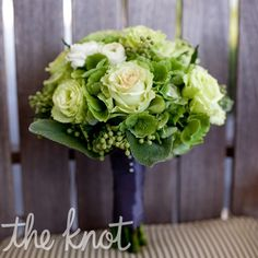 bridesmaids' bouquet  Christine's bridesmaids carried bouquets made up of green hydrangeas, jade roses, white ranunculus and berries with geranium leaves -- tied together with a dark pewter ribbon.