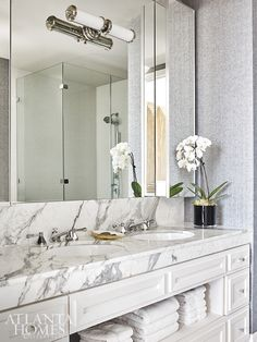 Reminiscent of men's suiting, the wallcovering by Holland & Sherry complements the thick marble in the master bathroom. Interior Architecture, Interior Design, Tulip Table, Atlanta Homes, Wooden Lamp, Upholstered Bench, Wall Sculptures, Master Bathroom, Clouds