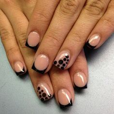 Stand out with this nude and black French tip combination. Based with nude colors, the nails are then tipped with black polish. Additional black polka dot accents are coated on top of the other nails in matte nude.