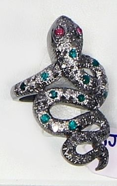 Snake Design Ring with PaveDiamonds and Emerald and Ruby Gemstones