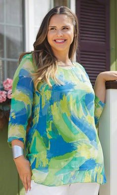 Sheer brush strokes lighten up the refined style of our Candace Tunic.     Contemporary woven style, perfect for any occasion!   Shown with our  Crinkle Cotton Crop Pants    Slight v-neckline    3/4 sleeves    Shell: 100% rayon, Lining: 100% cotton      Machine wash      37 long in size 5X      Imported