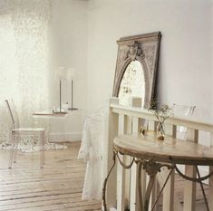 Some kind of clear acrylic side table would be cool next to white tufted chair!