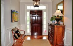 Beautiful Foyer. Love the heart pine floors.