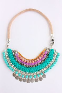 Vivid and colorful statement necklace. Made with woven cords, japanese ribbons, metal chains, crystal beads and metal pendants. Leather cord to hang