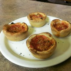 Mini Deep Dish Pizza. Made in a muffin tin. Whole milk mozzarella cheese first, then sausage or pepperoni. Topped with pizza sauce and Parmesan/Pecorino Romano.