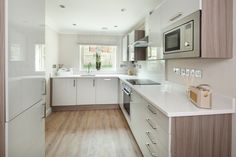 Modern kitchen by Emma & Eve Interior Design Ltd. https://www.homify.co.uk/ideabooks/33010/country-cottage-with-21st-century-appeal