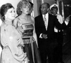 August 12, 1981: Prince Charles & Princess Diana give a dinner for President Anwar Sadat & his wife, Jihan on board the Royal yacht, Brittania at Port Said, Egypt during their honeymoon.