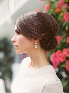 a sleek top and a small sided low bun for a timeless elegant look is suitable for medium and even short hair