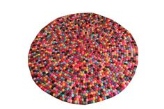 https://adetailedhouse.files.wordpress.com/2012/05/pom-pom-rug.jpg