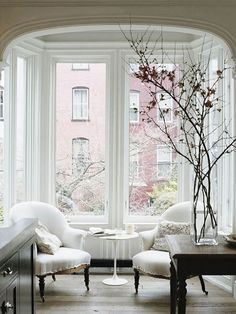 """B L O O D A N D C H A M P A G N E » TOWNHOUSE INTERIORS """"slipcover chairs in front of front window with tiny table."""