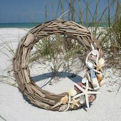 Intricately pieced driftwood wreath adorned with shells and nautical elements. Add more shells to make this your own creation!