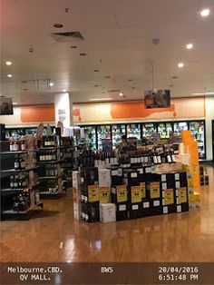 Giant Overhead bottle Sign of BWS liquor store at QV Mall   .BWS .QV-MALL Bottle Food-And-Drinks Liquor-Store Melbourne Signs