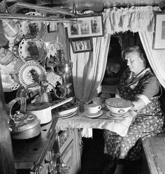 Ministry of Information Photo Division Photographer -- Mrs Skinner prepares the evening meal in the cabin of her husband's canal boat during 1944. -- High quality art prints, canvases -- Imperial War Museum Prints