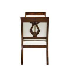 Sitzbank OLIVER aus Mahagoni mit vom Empirestil inspirierten Harfen-Schnitzereien und Messing. http://www.deSaive-deSign.de/Bank-OLIVER