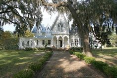 Rose Hill Mansion, historic gothic revival pre-Civil War home, former rice plantation house once part of Sir John Colleton's Devil's Elbow Barony granted by King Charles II in 1718. Now a private home within the gated community of Rose Hill Plantation.