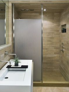 Amazing Bathroom Love the stonework and shades Nice shower door Sink a little too modern