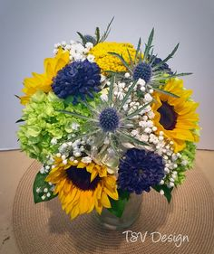Yellow, white, lime green, and navy bridal bouquet.