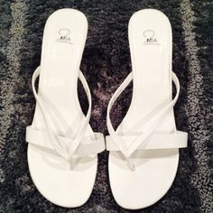 White Heels Worn   Great Condition   Normal Fading & Bottoms Dirty   All White   Thong Style   Man Made Materials   Small Stain ; Hardily Noticeable   Trades   Feel Free to Ask Questions   More  Upon Request   Bundles & Offers are Welcomed ❤️  MIA Shoes Heels