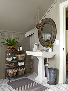 reclaimed-pine mirror over a pedestal sink from Home Depot in the master bathroom, where open wire cubbies offer more storage than a medicine chest. The trash can is actually an old planter. The walls are painted Flagstone by Martha Stewart Living. Pedestal Sink, Pedastal Sink Bathroom, Bathroom Beadboard, Craftsman Bathroom, Wainscoting, Yellow Bathrooms, Tiny Bathrooms, Blog Deco, Bathroom Inspiration