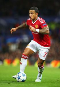 MANCHESTER, ENGLAND - AUGUST 18:  Memphis Depay of Manchester United in action during the UEFA Champions League Qualifying Round Play Off First Leg match between Manchester United and Club Brugge at Old Trafford on August 18, 2015 in Manchester, England.  (Photo by Alex Livesey/Getty Images)