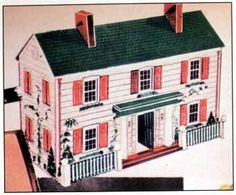 RICH factory-made Colonial dollhouse... I think this comes closest to the dollhouse I had.