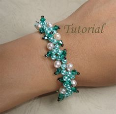 In this tutorial you'll learn how to make a beaded tropical forest vine bracelet with crystal bicones, freshwater pearls, pearl and seed beads. Beading is made easy with these step-by-step instructions and full color illustrations. Nature loving has prompted me to craft this interesting bracelet. Fancy letting the tropical vine grow and drape around your wrist – bringing on sunshine into your life. Weave your favorite freshwater pearls into a luxurious and elegant vine with some luscious…