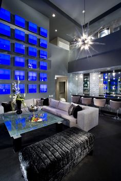 I love the windows or tv screens or some sort of panels on the wall in living room of this Las Vegas Penthouse.