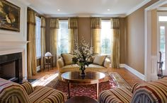 Hang curtains to the ceiling right below the molding