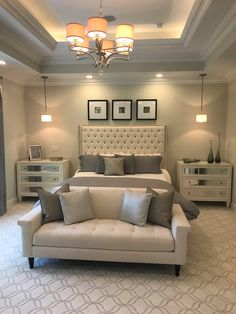 ELEMENT-LIGHT Five different types of lighting are used in this bedroom; natural light from the windows, center chandelier, recessed cans outlining the ceiling, recessed lights within the tray ceiling and the pendant lights.