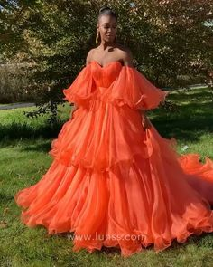 Amazing flounced puffy orange chiffon layered floor length ball gown with puffy short sleeves. Strapless bodice with V neckline.