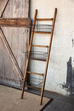 wire baskets attached to the rungs of a short, wooden ladder