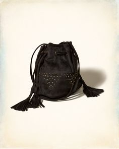 Designed with tassel-ties drawstring closure on sides with a Hobo vibe, featuring metal details and a long crossbody strap.
