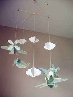 These planes fly dreamily among the clouds in this adorable 3D mobile. Made of card stock, the clouds and planes are light enough to be moved by even a gentle breeze. The entire combination is about high 36 inches,each plane is about 6x8x3 inches. Each combination has four planes, four white clouds (a big three small) I also include a white cup hook that can be screwed into your ceiling to hang the mobile from.  This material is every square metre 300 grams weight cardboard , it is very…