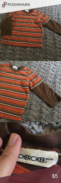 Boys shirt Oh no! We cut the tag off and now I can't tell you the size 🤦♀️. I would say 3T, I compared with another shirt. My dude wore this around ages 3 and 4. Cherokee Shirts & Tops Tees - Long Sleeve