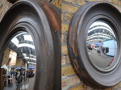 Fisheye mirror. Nice convex mirror with deep gesso frame. Initials 'BK' carved on the back.  origin: uk  year: 1950