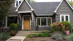slate roof, gray house, white trim
