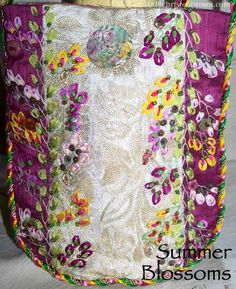 Summer Blossoms purse is made from silk and a vintage tambour embroidered fabric from India. Embroidered with silk ribbons and cotton threads with a beautiful china transfer mother of pearl buttons.