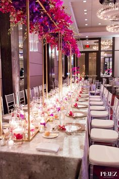Wedding party headtable with custom floral structures and cylinders with floating candles and submerged flowers for winter wedding reception at The Joule Hotel in Dallas, Texas - Photos by Perez Photography