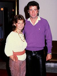 Swedish pop/gospel singer, Carola with John Travolta (1983) She won the Eurovision Song Contest for Sweden in Rome in 1991.