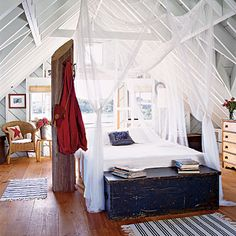 """""""There's something so innocent and effortless, yet sexy, about an open-air room with high-beam ceilings and breezy mosquito nets. Makes me want to sleep all day."""" —Bradley Nesbitt, assistant market editor~ Coastal Living"""