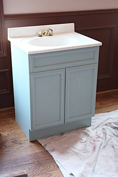 REpaint that ugly vanity that came with the house for the shop bathroom!