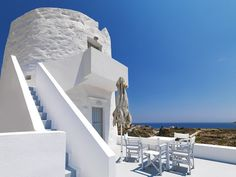 """The Windmill Hotel.  Located between the port of Kimolos and """"Chorio"""", the only village of the island, this perfect getaway invites you to experience the charm and authenticity of Greek hospitality, taking in the relaxing atmosphere and exploring this unspoiled island."""