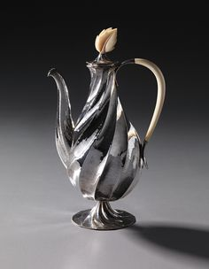 DAGOBERT PECHE - Rare coffee pot, model no. S 5073, designed 1920, executed 1923-1926. Silver, ivory. 31.3 cm (12 3/8 in.) high. Executed by the Wiener Werkstätte, Austria.
