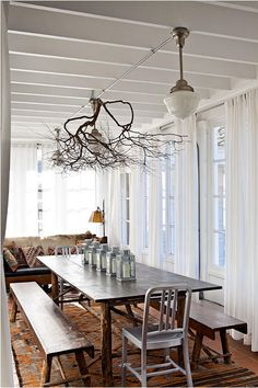 Lincoln Barbour rustic table and branch chandelier of a sort
